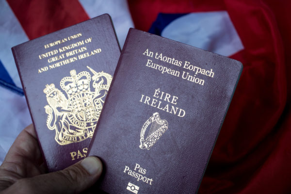 WELLS, ENGLAND - AUGUST 02:  In this photo illustration a man holds a passport of the United Kingdom besides a Irish passport on August 2, 2017 in Wells, England. Applications for Irish citizenship from people in the UK with Irish ancestry has doubled since the Brexit vote as people seek to secure an EU identity after Britain leaves the European Union.  (Photo by Matt Cardy/Getty Images)